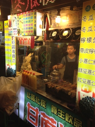 Man selling sugar cane at a night market