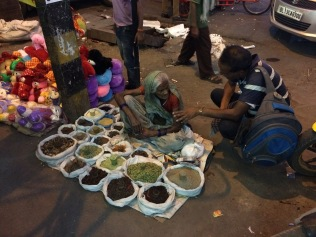 Woman selling seeds and spices at a night market