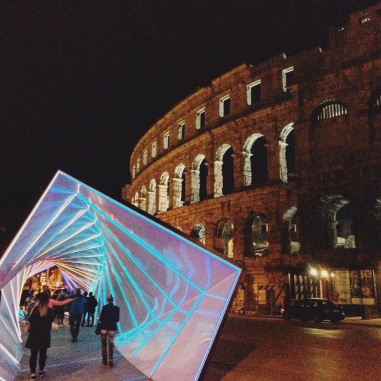 Pula Arena at night, accompanied by installations from the Visualia Festival